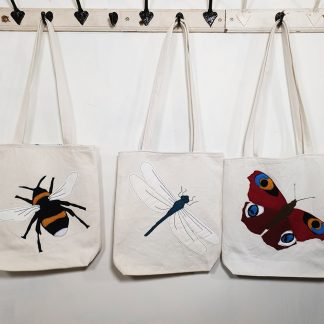 Appliqued canvas tote bags with dragonfly, butterfly and bee designs