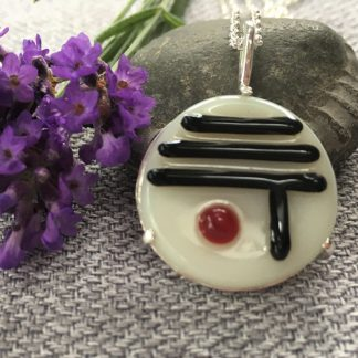 Circular Fused Glass pendant in white with black lines and red dot Japanese design mounted in sliver on a silver chain