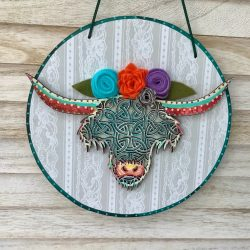 Highland Cow art , layered wood on a circle plaque with felt flowers.