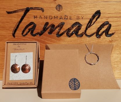 100% recycled gift boxes made from 100% post consumer waste. Made in the UK. Image shows a pillow box, earrings in a box and makers logo. Jewellery for illustration purposes only