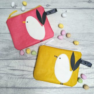 Mustard and pink oilcloth purses with chick motif