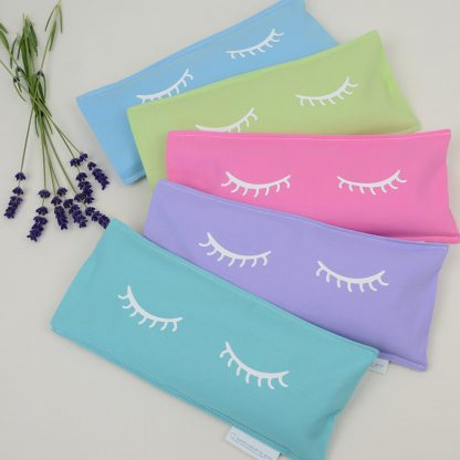 Collection of five pastel coloured lavender eye pillows with eyelash design