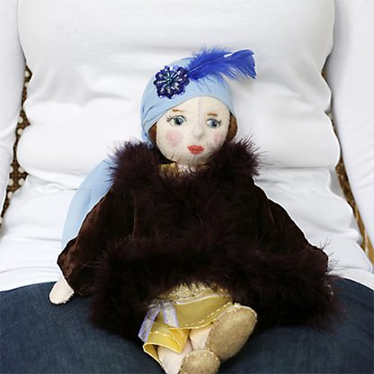 Flapper doll sitting on lap to show size