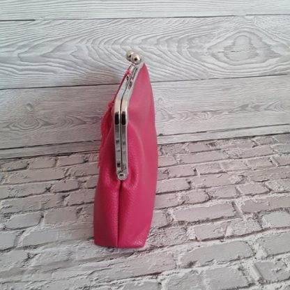 Evening clutch in pink faux leather