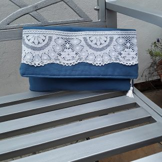 Hand held clutch with antiqud lace trim on blue
