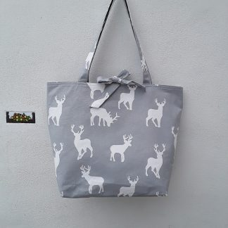 Large shopping bag with white stags on grey, lined with toning stripes, tie top fastening