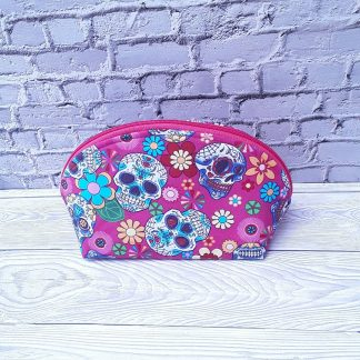 Make up bag, sugar skulls on fuschia pink