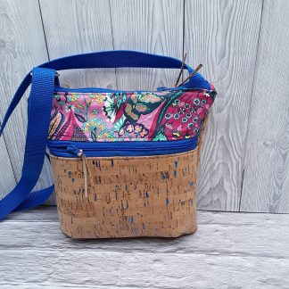Cross body shoulder bag in cork with sparkly blue flecks, two zip pockets, adjustable shoulder strap, medium size
