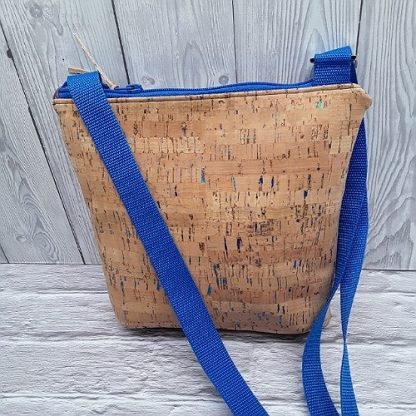 Cross body shoulder bag in natural cork with sparkly blue flecks, two zip pockets and adjustable strap