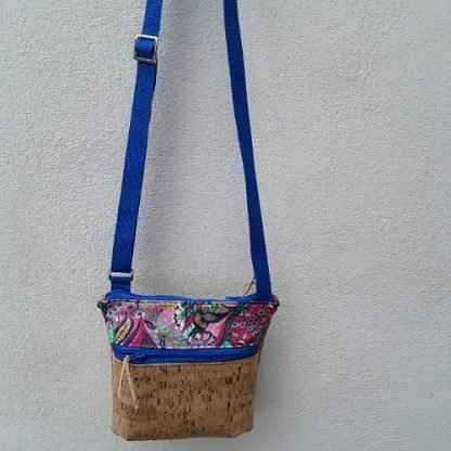 Cross body shoulder bag in cork with sparkly blue flecks, two zip pockets and adjustable strap, medium size