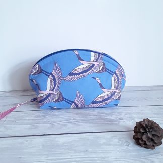 Make up bag with pink and blue flying cranes and all round zip for easy access