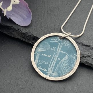 teal green/grey thistle print and sterling silver halo pendant