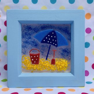 Blue Box Frame featuring Blue umbrella and a bucket and spade