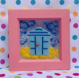 Deep pink hand painted wooden box frame with turqoise beach hut