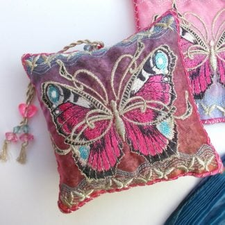 Pink coloured Butterfly as a sqaure design for a scented lavender bag showing the beads of the tasselled hanging loop