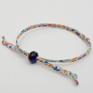 Primary coloured liberty bracelet with navy and red bead