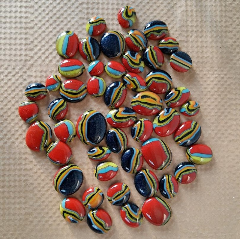 Fused glass puddles in swirls of different colour
