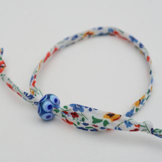 Primary coloured liberty bracelet with handmade blue glass bead
