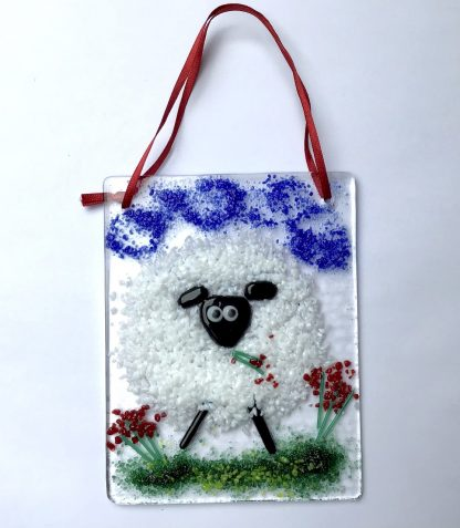 Fused Glass Sheep muching red flowers