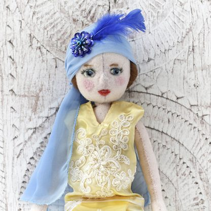 Upper body of 1920s flapper doll showing decoration on dress