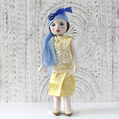 Flapper doll from 1920s in party dress