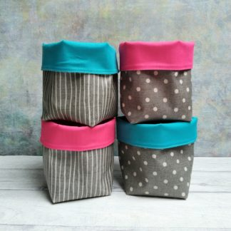 Small grey oilcloth storage pot with choice of pink or turquoise lining