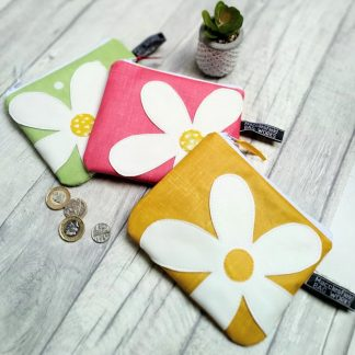 oilcloth purse with daisy motif in three colourways