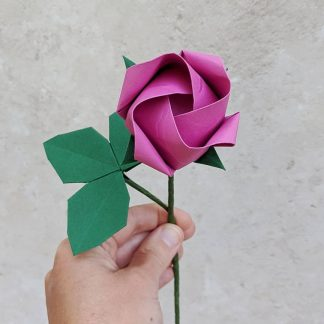 single pink origami rose