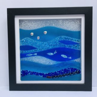 Fused Glass Dichroic fish on blue waves