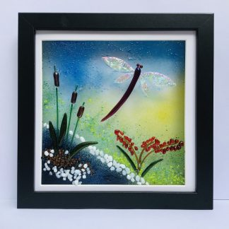 Fused Glass box frame featuring a dragonfly with dichroic wings and bullrushes