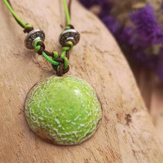 Handmade by Tamala presents a lime green pendant on an adjustable satin cord. Hints of gold flash in the light with this pendant. Tibetan silver beads provide a lovely finishing detail. Lime green and chocolate brown cord allow the length to be adjusted