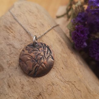Handmade by Tamala presents A Random Beauty. Marks randomly made in the copper has created a lovely floral look. On a silver chain