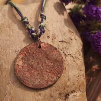 """Handmade by Tamala presents Purple Moon. It's copper forged with fire and held on a purple and green adjustable cord. Length at it's shortest is 15"""" at it's longest 26"""". The pendant is 25mm. Jade beads finish the cord adding a lovely detail"""