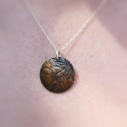 Handmade by Tamala presents A Random Beauty. Marks randomly made in the metal have created a lovely floral look. This is a petite pendant suitable for every day wear