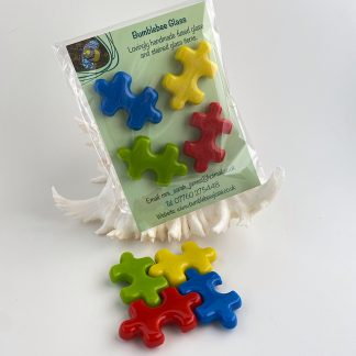 Fused glass puzzle piece shaped fridge magnets