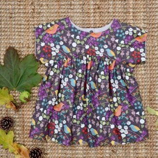 Autumn leaves and bird print girls top with short sleeves, curved bodice and gathered skirt. Back placket opening with poppers