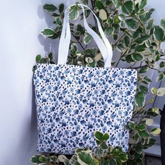 "Reversible shopping bag, cotton, large size 17"" by 14"", strong straps, blue flowers on white or reverses to white spots on deep pink"