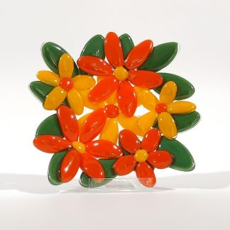 Orange and yellow glass flowers dish on a plate stand