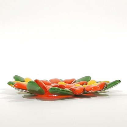 Side view of orange and yellow glass flowers dish