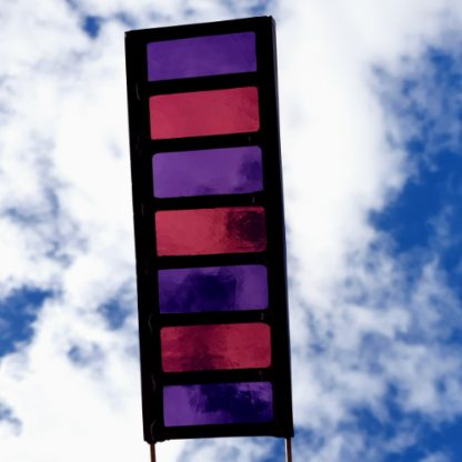 Purple garden stake held up to sky