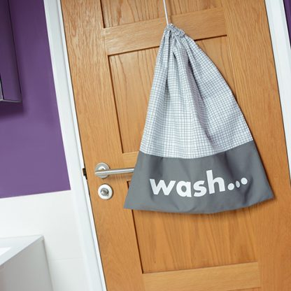 Fabric drawstring laundry bag with screen printed word 'Wash'