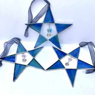 a trio of stained glass blue green stars with wire and bead embellishment