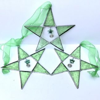 A trio of stained glass pale green stars with wire and bead embellishment