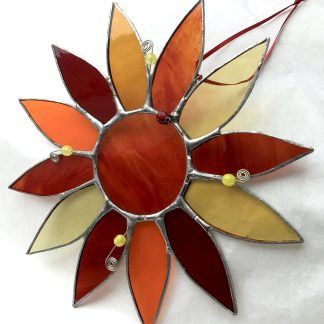 stained glass sunflower with ladybird bead