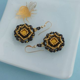 Black and gold beaded statement earrings