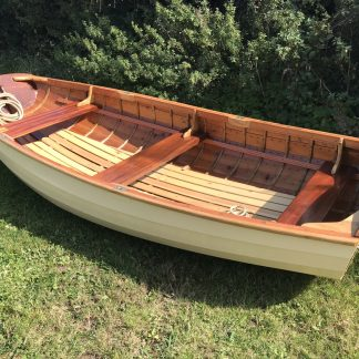 Wooden clinker pram dinghy.