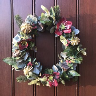 Front door wreath with Christmas roses, eucalyptus and limes