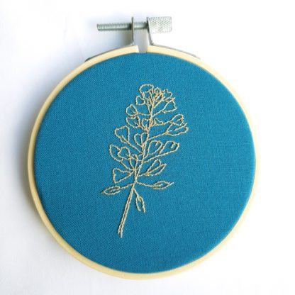 shepherd's purse embroidery on teal background