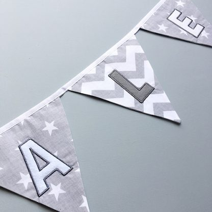 Personalised Grey & white embroidered bunting close up of letters
