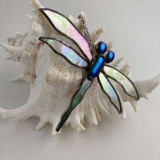 Stained glass dragonfly with dichroic accents and iridised wings